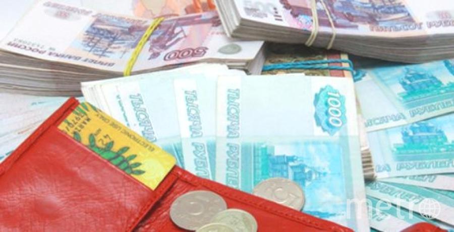 Деньги могут быть разносчиком вируса. Фото Getty