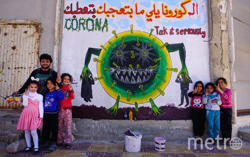 Коронавирус вдохновляет стрит-арт художников. Граффити в Биннише. Фото AFP