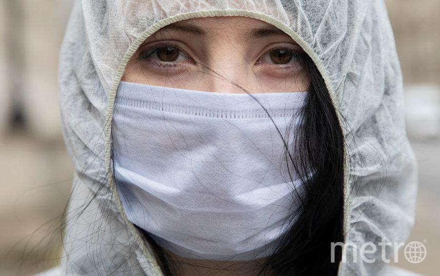 Вирус может жить на поверхности маски до 7 дней. Фото Getty
