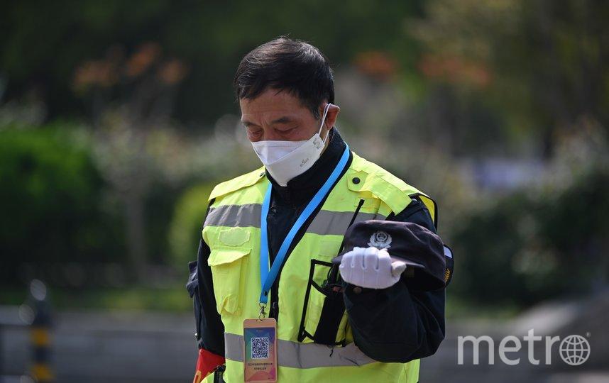 Жители страны почтили память умерших от Covid-19 тремя минутами молчания. Фото AFP