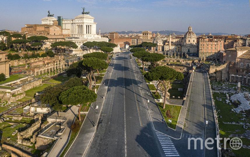 Опустевшая улица в Риме, Италия. Фото AFP