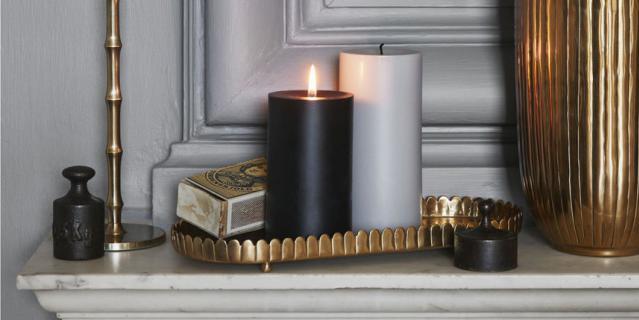 Большая парафиновая свеча H&M Home (399 руб.).