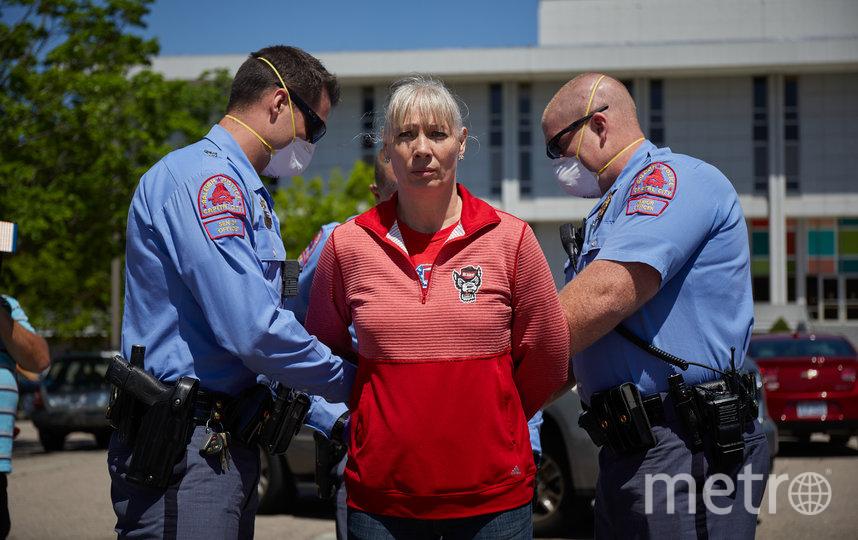 Жительницу Северной Каролины арестовали после того, как она отказалась покинуть парковку, на которой проходила акция протеста. Фото AFP