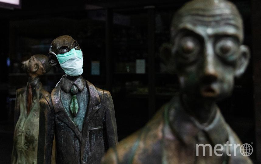 """Статуя """"Три бизнесмена принесли обед"""". Мельбурн, Австралия. Фото Getty"""