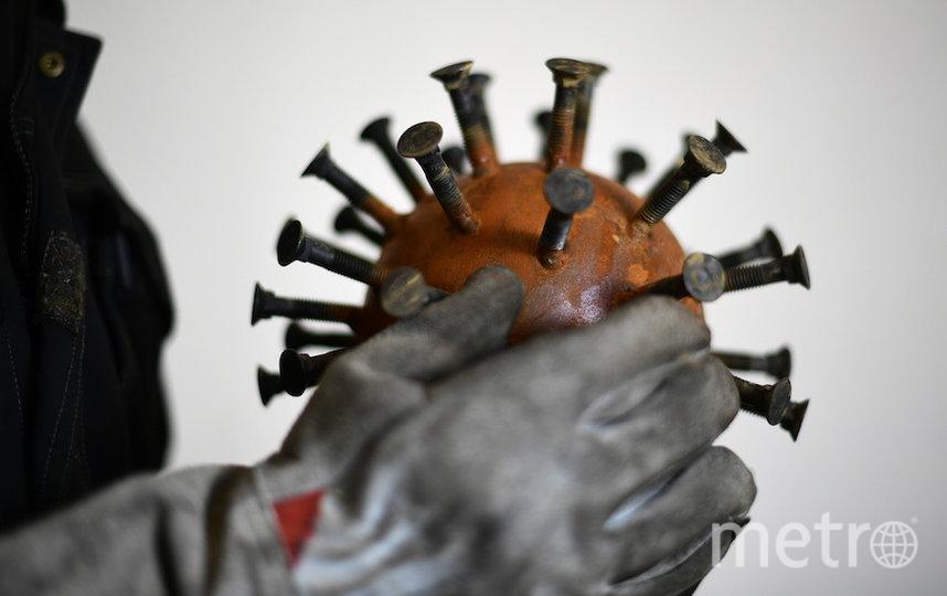 Так люди представляют себе коронавирус. Фото AFP