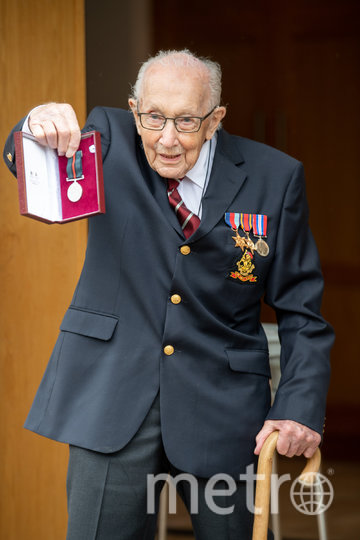 Тому Муру присвоили звание почетного полковника. Фото AFP