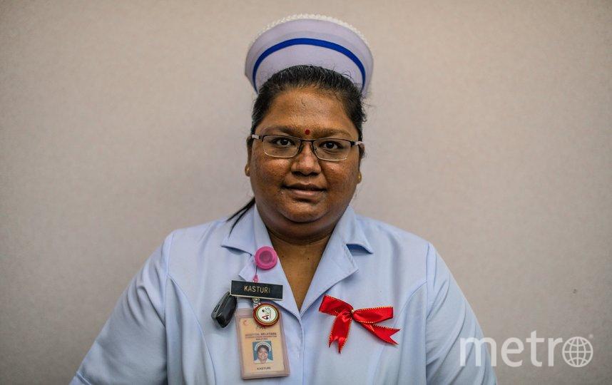 Медсестра в Малайзии, фотосессия в честь праздника. Фото AFP