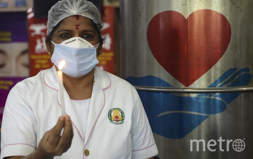 Медсестра в Индии. Фото AFP