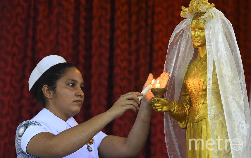 Медсестра, Шри-Ланка. Фото AFP