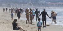 Мир наслаждается частичным снятием карантина на пляжах, в парках и ресторанах: фото