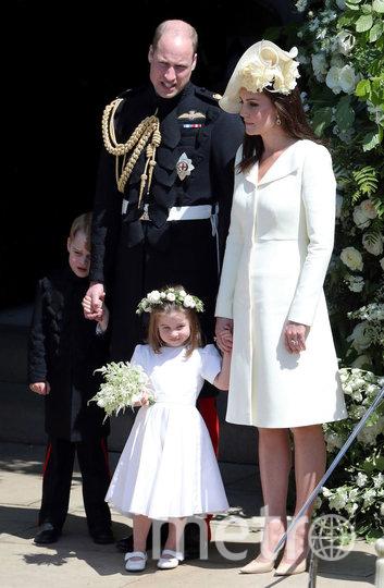 Принц Уильям и Кейт Миддлтон с детьми Джорджем и Шарлоттой на свадьбе принца Гарри и Меган Маркл. Фото Getty