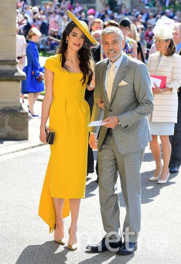 Джордж Клуни с женой на свадьбе принца Гарри и Меган Маркл. Фото Getty
