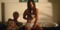 Новый клип с Меган Фокс в нижнем белье подогрел слухи, что она ушла от мужа к музыканту