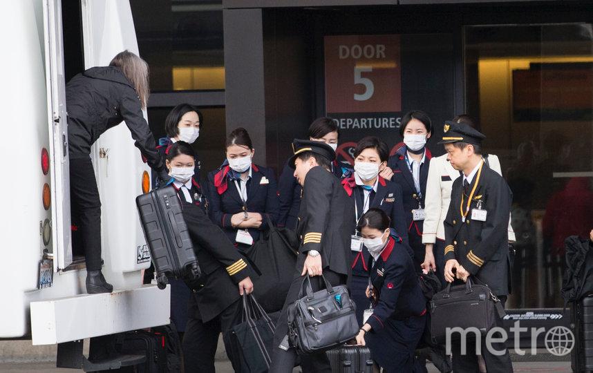 Проверка температуры пассажиров и посетителей аэропортов отменяется, но сохраняется для членов экипажей. Фото Getty