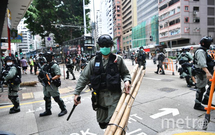 Для разгона демонстрантов полиция применила слезоточивый газ и водомёты. Фото AFP