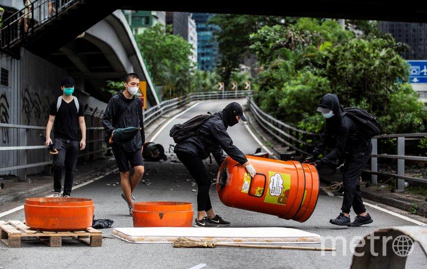поводом для демонстраций стало намерение властей принять закон об обеспечении национальной безопасности. Фото AFP