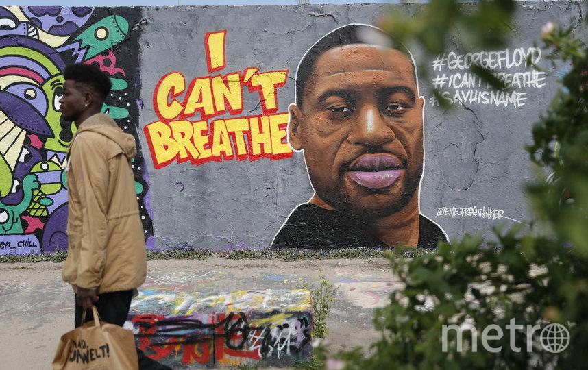 Портрет Джорджа Флойда на остатках Берлинской стены. Фото AFP
