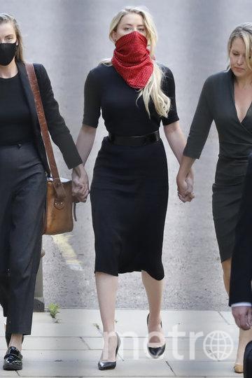 Эмбер Хёрд прибыла в здание Высокого суда в Лондоне. Фото AFP