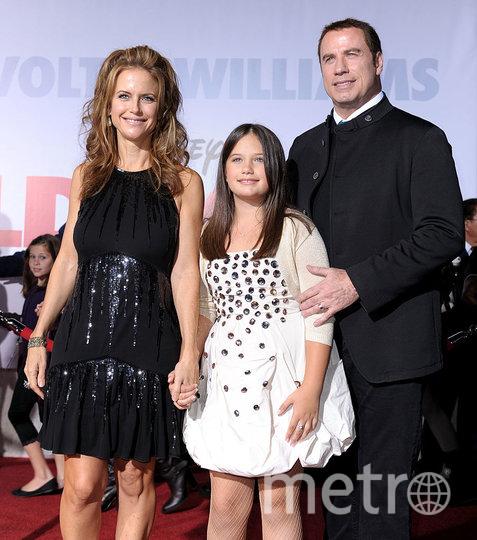 Траволта с женой и дочкой. 2009 год. Фото Getty