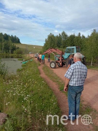 Операция по вызволению машины на берег. Фото предоставила Мария Петрушенко