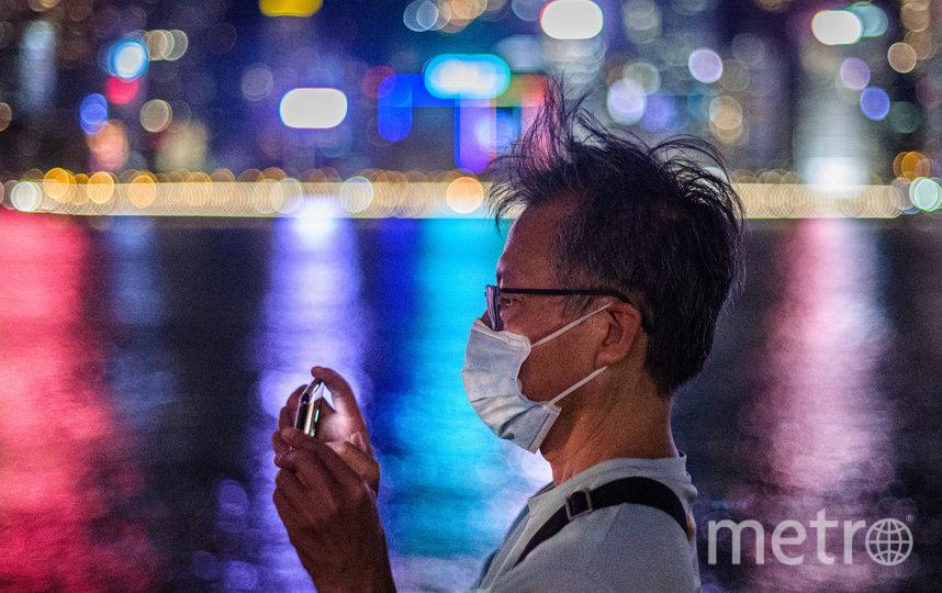 57 новых случаев в Китае связаны с передачей инфекции внутри страны. Фото AFP