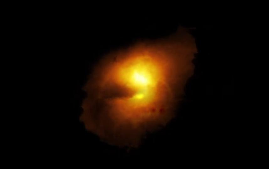 Компьютерное моделирование помогло исследователям восстановить реальную форму галактики. Фото  European Southern Observatory (ESO), Скриншот Youtube