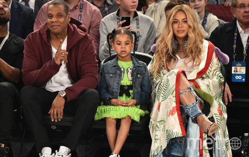 Бейонсе и Jay-Z с дочерю. Фото Getty