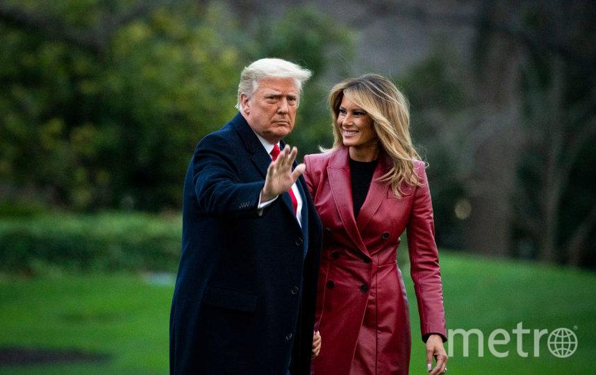 Мелания Трамп в красном пальто в Джорджии. Фото Getty