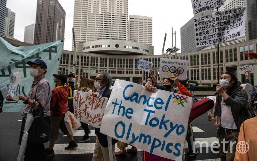 Местные жители требовали отменить проведение Олимпиады не только в соцсетях. Фото Getty