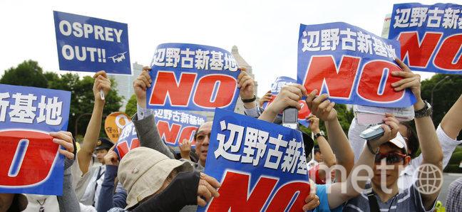 Shizuo Kambayashi/AP.