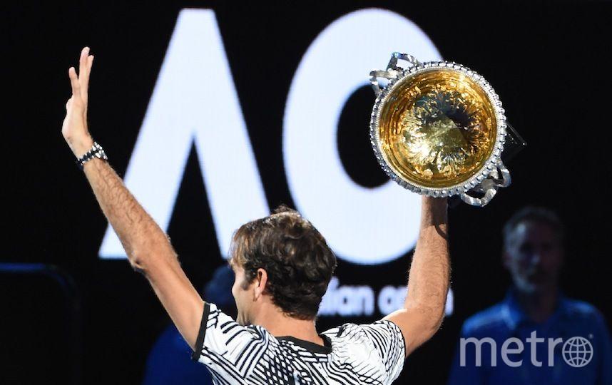 Федерер с очередным трофеем. Фото AFP