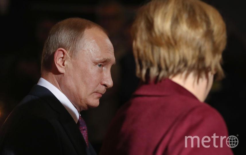 Ангела Меркель и Владимир Путин. Фото Getty