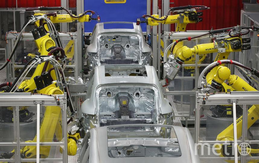 Роботы на производстве. Фото Getty