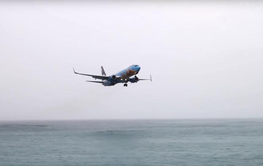 Посадка в международном аэропорту Принцессы Юлианы на острове Сен-Мартен. Фото ATCpilot., Скриншот Youtube