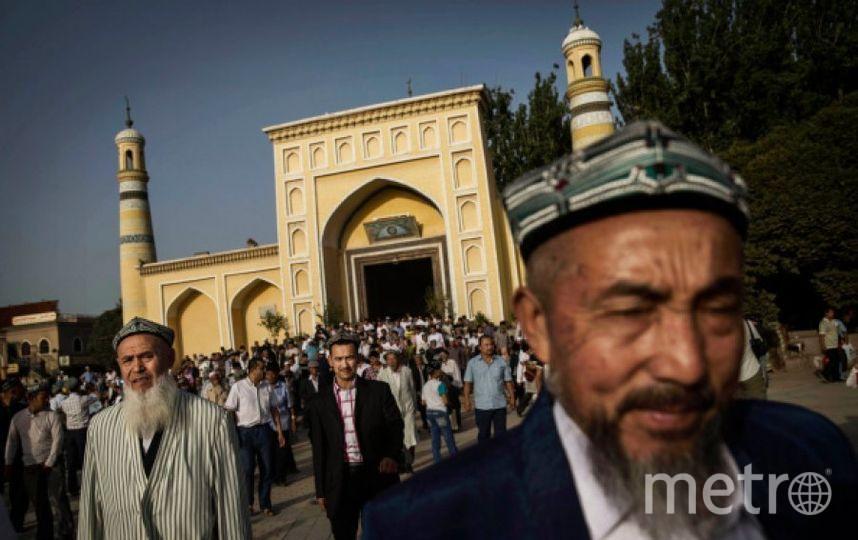 Жители Синзцяна. Фото Getty