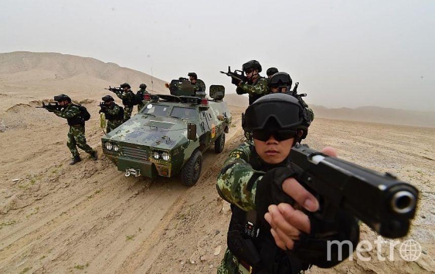 Китайские военные в Синцзяне. Фото Getty